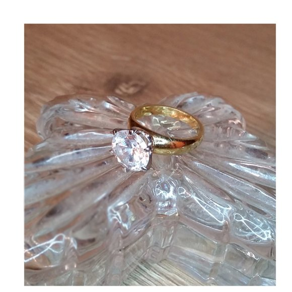 Faux diamond prong gold tone costume ring